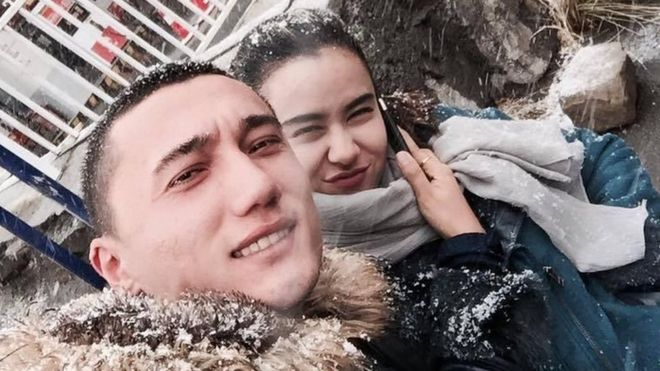 Sadam Abudusalamu and Nadila Wumaier pose for a selfie in the snow in China