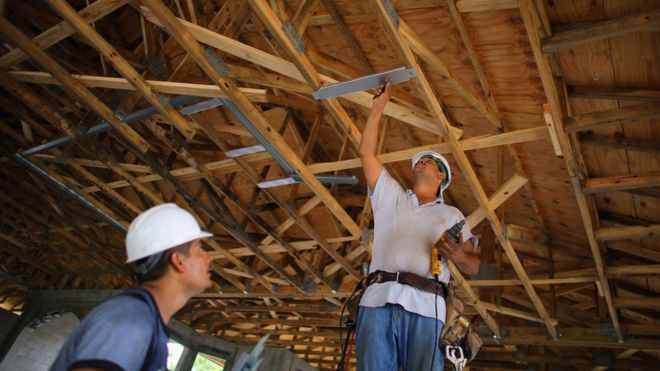 Construction workers, Louis Delgado (L) and Tony Rodriguez work on building a Toll Brothers Inc. home on September 26, 2012 in Boca Raton, Florida