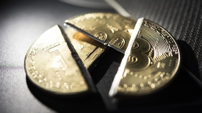 A visual representation of the digital Cryptocurrency, Bitcoin, which has been cut in half.