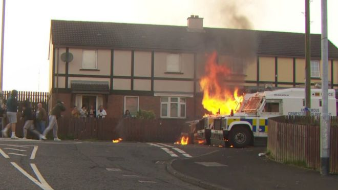 Police being attacked with petrol bombs in the Creggan
