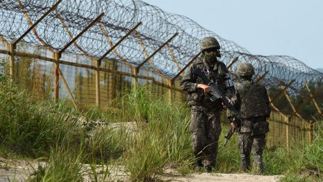 South Korean soldiers patrol at the North Korean border, 10 August 2015
