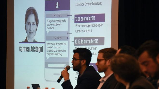 Information on Mexican journalist Carmen Aristegui is displayed on a screen during a journalists' press conference in Mexico City on June 19, 2017