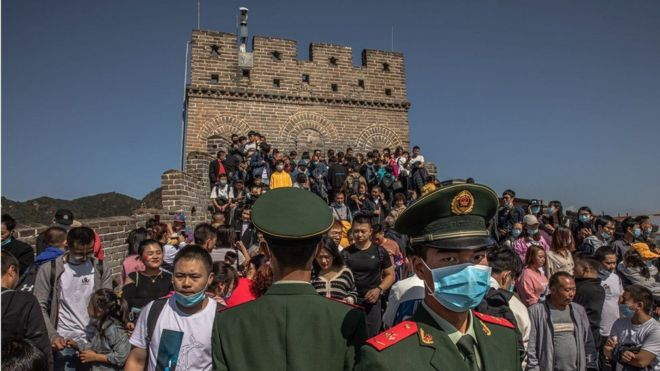 Scores of people are seen on the Great Wall of China