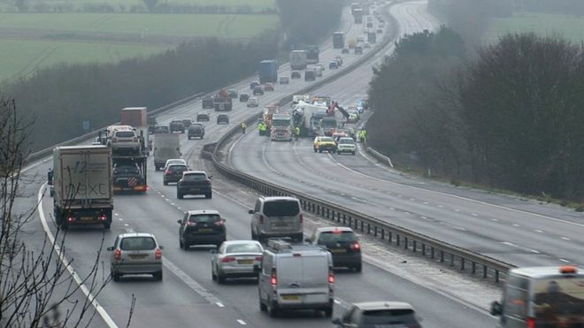 Arrest after three-vehicle crash shuts M11 near Stansted - BBC News