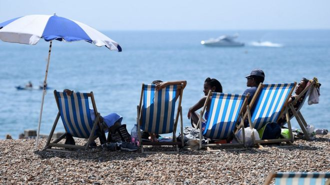 People enjoying the hot weather on Brighton beach in July 2018