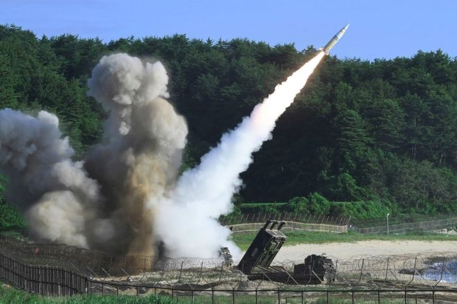 This handout photo taken on 5 July 2017 and provided by South Korean Defence Ministry in Seoul shows US M270 Multiple Launch Rocket System firing an MGM-140 Army Tactical Missile from an undisclosed location on South Korea's east coast during a South Korea-US joint missile drill aimed to counter North Koreas ICBM test.