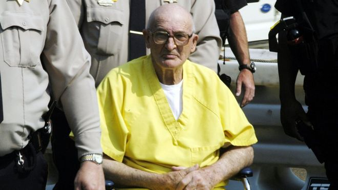 Edgar Ray Killen, seen in a yellow prison-issue jumpsuit, in 2005