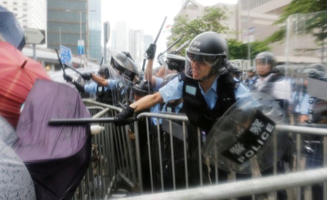 Riot police clash with protesters in Hong Kong, 12 June