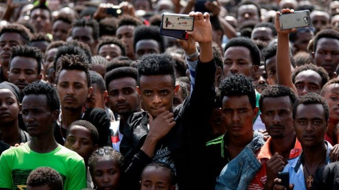 People gather for the rally of Ethiopia's new Prime Minister in Ambo, about 120km west of Addis Ababa, Ethiopia, on April 11, 2018