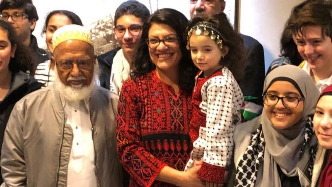 Ms Tlaib poses with supporters on her first day in Washington