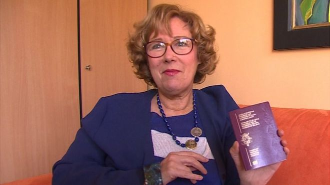 Glynis Whiting holding her new Belgian passport