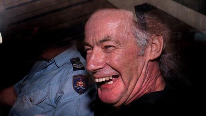 Ivan Milat laughing in the back of a car