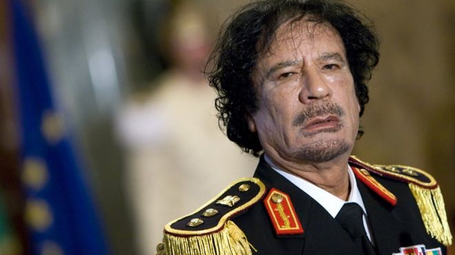 Muammar Gaddafi during a news conference at the Quirinale palace in Rome June 10, 2009