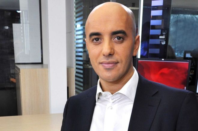 A head and shoulders picture of Redoine Faid in a white shirt and suit