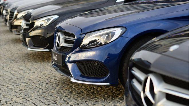 A row of Mercedes Benz cars