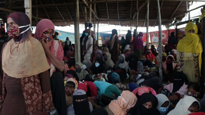 Rohingya refugees take rest after disembarking from a boat at Rancong Beach, Lhok Seumawe, North Aceh, Indonesia, 07 September 2020