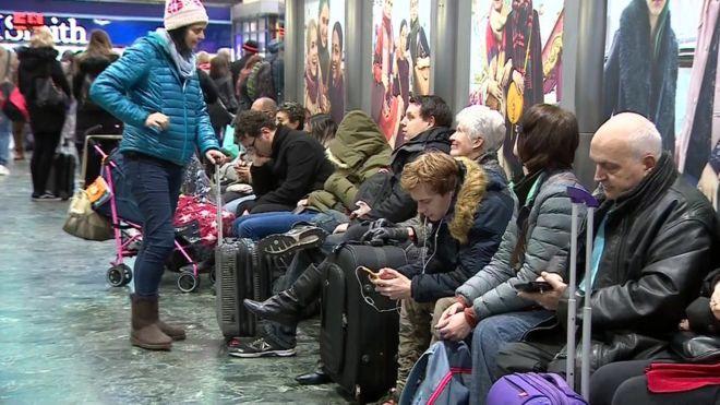Passengers await news at London Euston