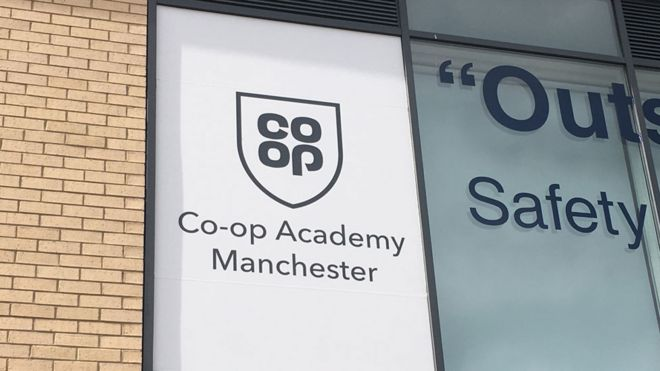 Co-op logo on school