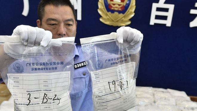 The police officer shows the seized crystal meth on May 18, 2016 in Guangzhou, Guangdong Province of China.