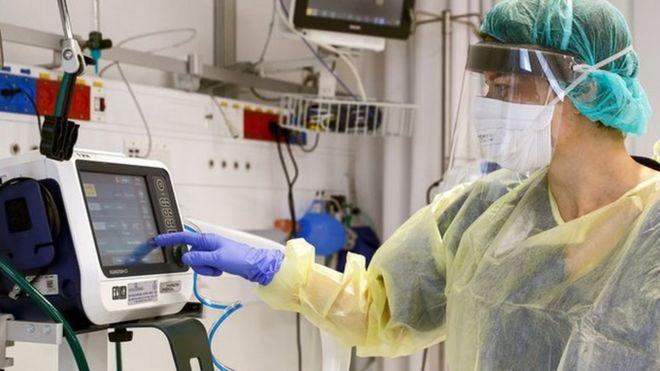ITU technician monitors a patient