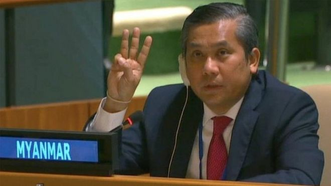 Myanmar's ambassador to the United Nations Kyaw Moe Tun holds up three fingers