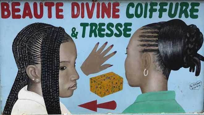 A hair salon hand-painted advertisement sign