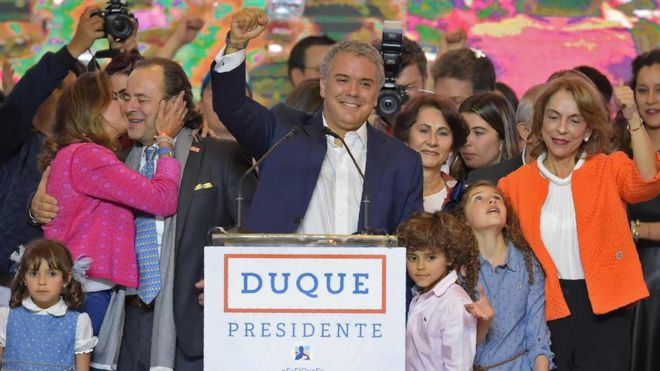 Newly elected Colombian president Ivan Duque (C) celebrates with his family and supporters in Bogotá, after winning the presidential runoff election on June 17, 2018