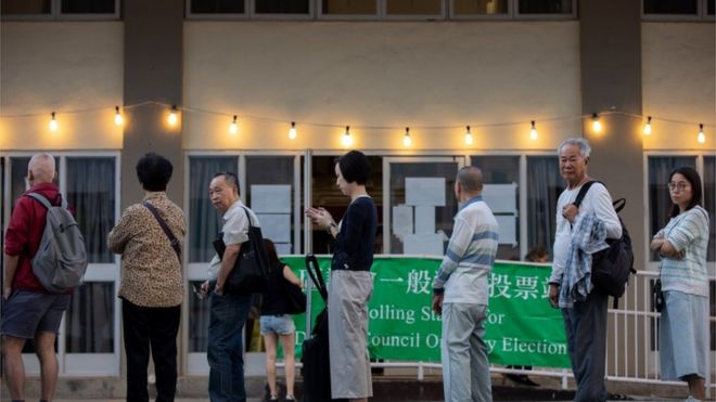 Hong Kong voters queue to cast their ballots in district council elections