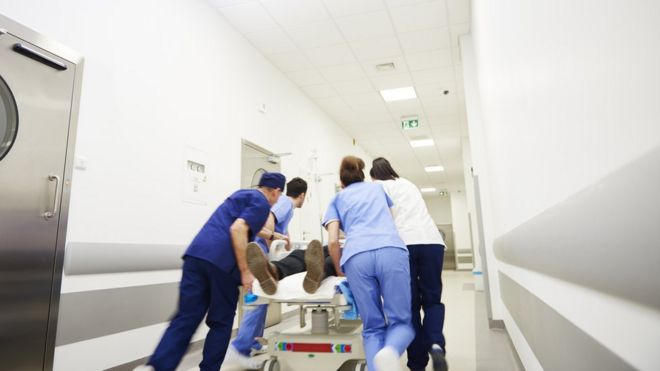 Medical staff transferring patient