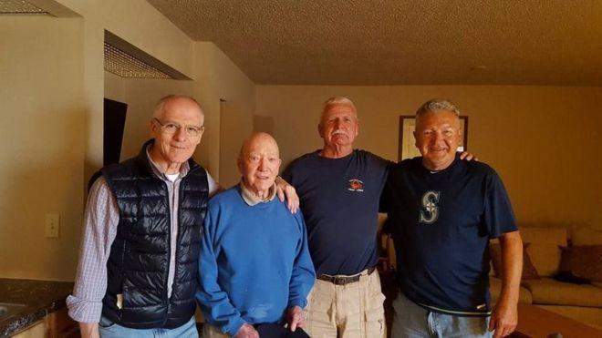 Raffaele Minichiello (far left) and Otis Turner (far right) at a military reunion