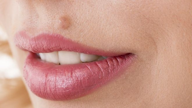 Mole on lip meaning