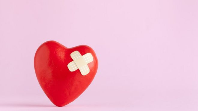 A heart covered in a bandage