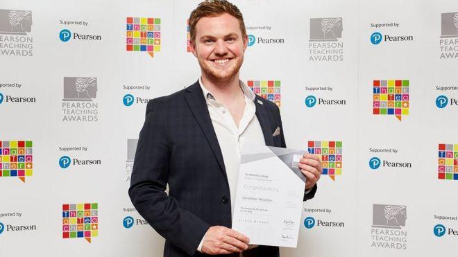 Jonathan Wharton with award