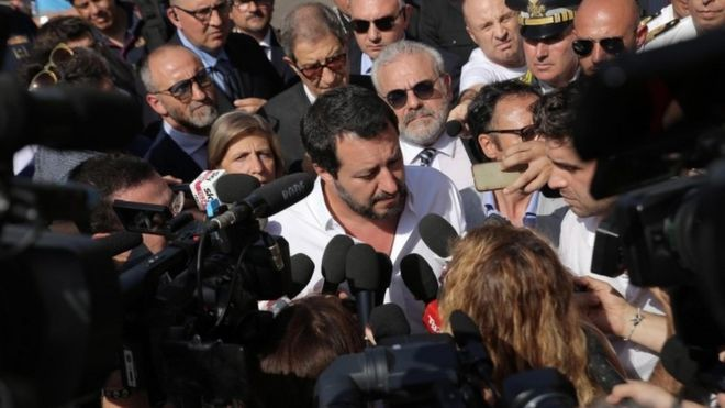 League leader Matteo Salvini is surrounded by reporters