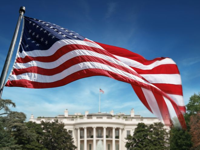 American flag in front of the White House in Washington D.C.