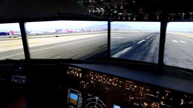 Man builds flight simulator in Barnsley dining room - BBC News