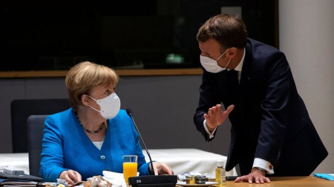 Angela Merkel and Emmanuel Macron wear masks at an EU summit in Brussels