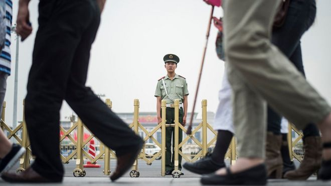 A Chinese paramilitary guard stands in Tiananmen Square in Beijing on June 3, 2016
