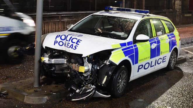 Police car extensively damaged after traffic light crash - BBC News