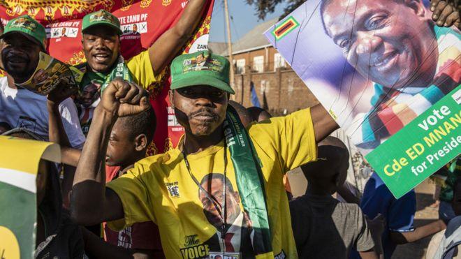 A Zanu-PF supporter in Zimbabwe celebrating