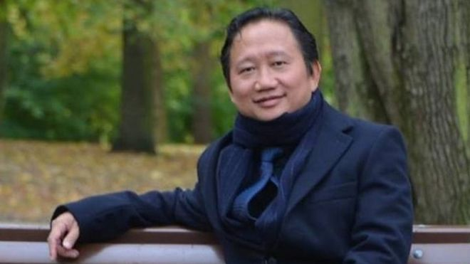 Vietnamese national Trinh Xuan Thanh sitting on a park bench in Berlin