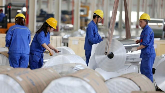 Chinese workers packaging aluminium tapes at an aluminium production plant in Huaibei, east China's Anhui province