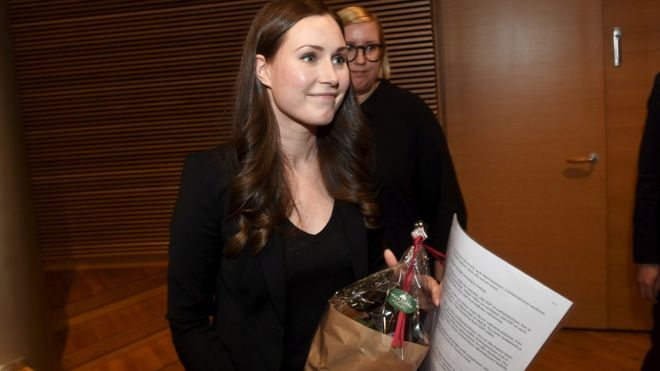 Sanna Marin holding flowers