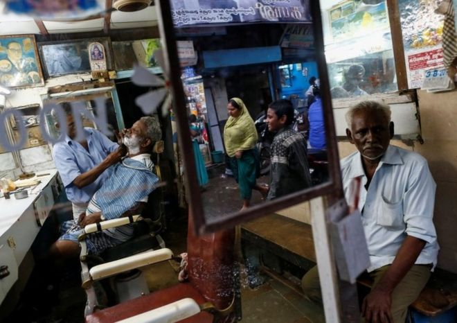 Why the Indian barbershop is a unique institution - BBC News