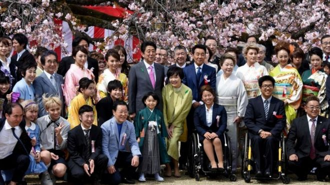 Prime Minister Shinzo Abe (centre left) posing with entertainers and athletes during the cherry blossom viewing party hosted by the prime minister in 2017