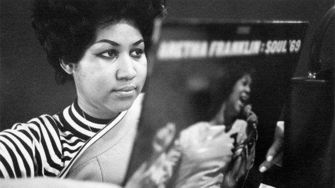Aretha Franklin holds a copy of her Soul 69 album in New York City