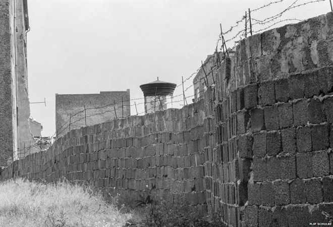 A stretch of the Berlin Wall, 1962. The wall was topped with barbed wire to prevent East Berliners from escaping