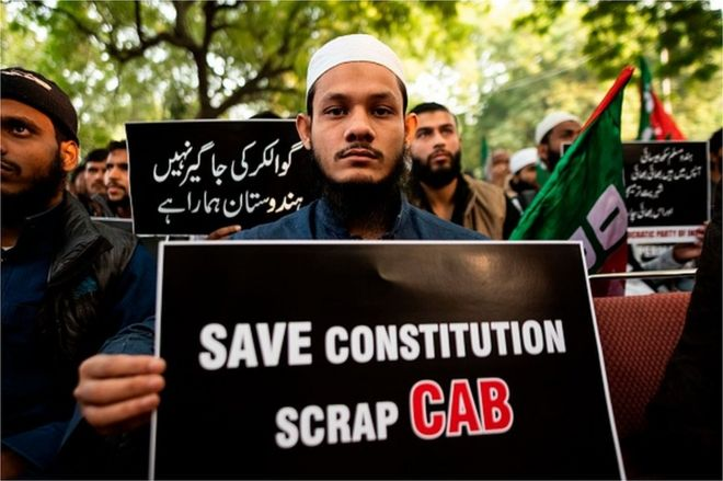 Demonstrators display placards to protest against the government's Citizenship Amendment Bill (CAB) in New Delhi on December 10, 2019