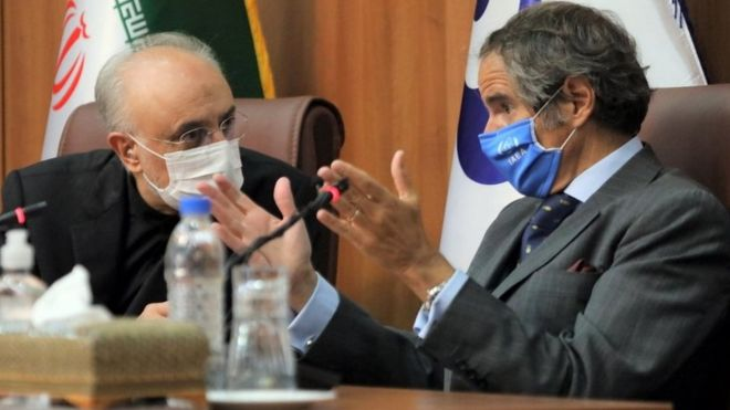 A handout photo made available by the Atomic Energy Organisation of Iran office shows its chief, Ali Akbar Salehi (L), and the Director General of the International Atomic Energy Agency (IAEA), Rafael Mariano Grossi (R), during a joint press conference in Tehran, Iran (25 August 2020)
