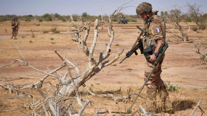 A French soldier clears mines in Burkina Faso